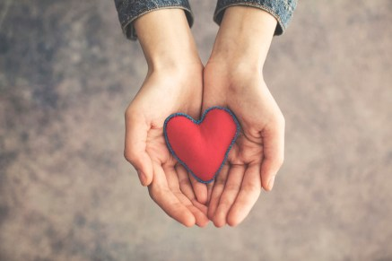 Woman's hand holding a heart. Image signifies relationship help for lesbians by attending intensive relationship therapy for lesbians or a hold me tight couples workshop for lesbians.