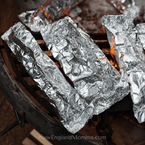 food wrapped in aluminum foil on a grill