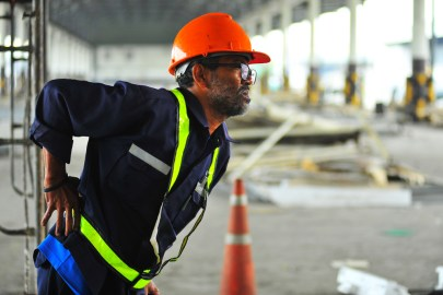Worker holding his back in pain