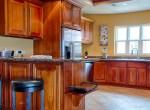 luxury-condo-belize-kitchen-770x386