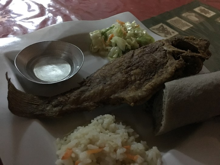 This is what you get at a restaurant rather than a shack (note that restaurant here just means somewhere with a proper kitchen; it could be nice or dingy). The injera, rice and salad suit the fish well!