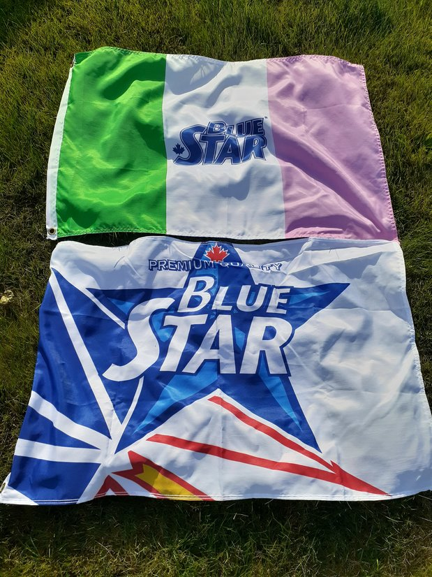 Ble Star Beer Flags on the grass