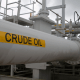 Oil prices inch higher on output cut support, but US coronavirus spike caps gains