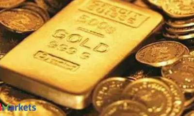 Gold dips on firm dollar as focus turns to Powell, Yellen