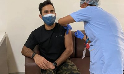Dinesh Karthik Gets COVID-19 Vaccine Jab, Chris Lynn Trolls His Camouflage Pants | Cricket News