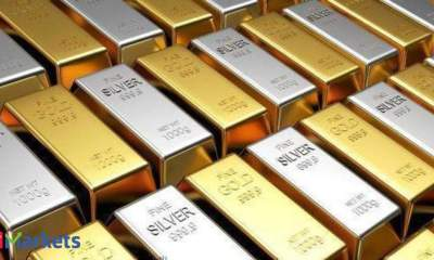 Gold declines by Rs 365; silver gains marginally