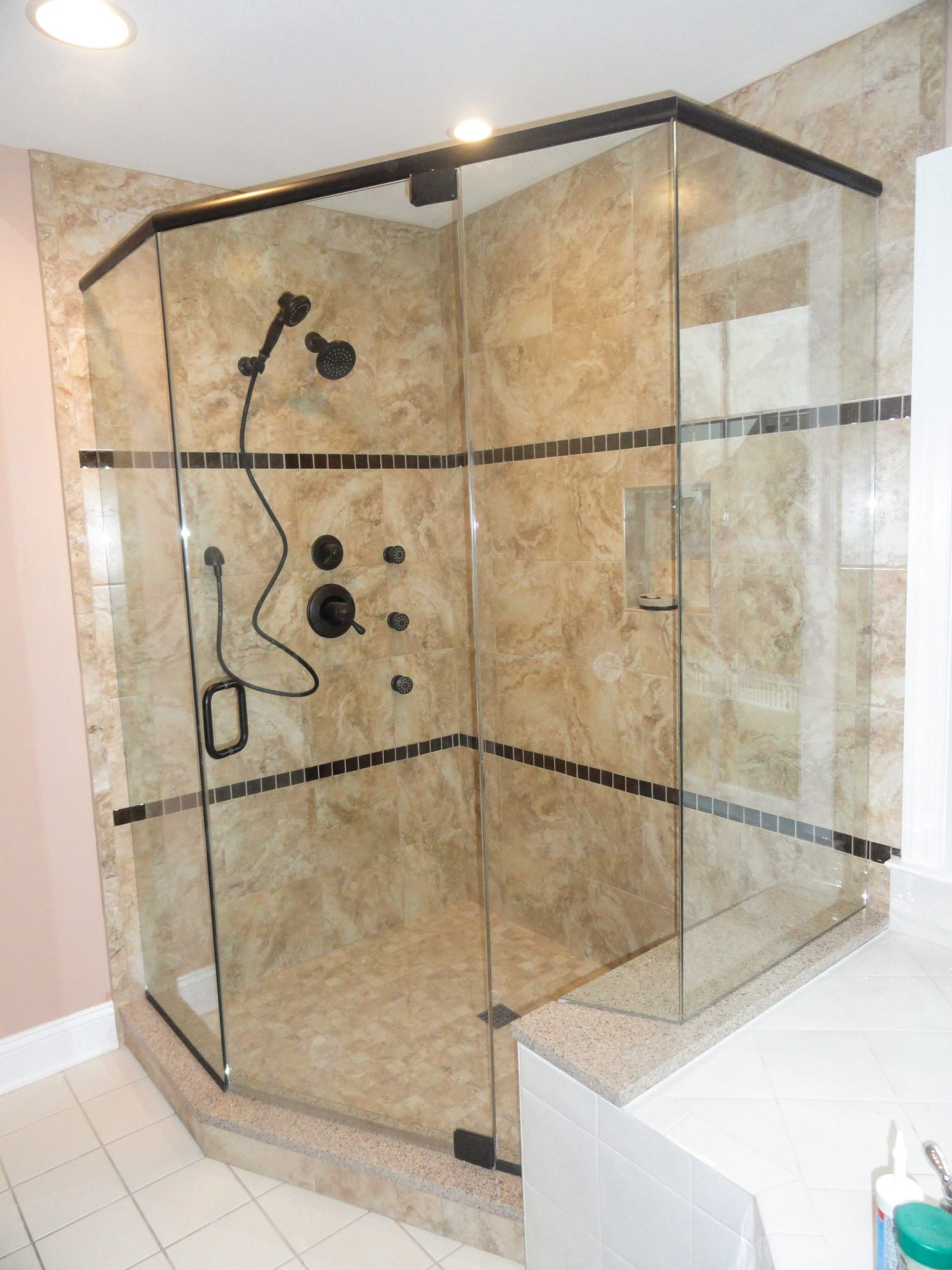 Neaoangle Shower Using Oil Rubbed Bronze Hardware And Deluxe