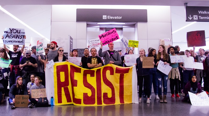 RESIST sign at SFO #noban Protest -Jan 29, 2016