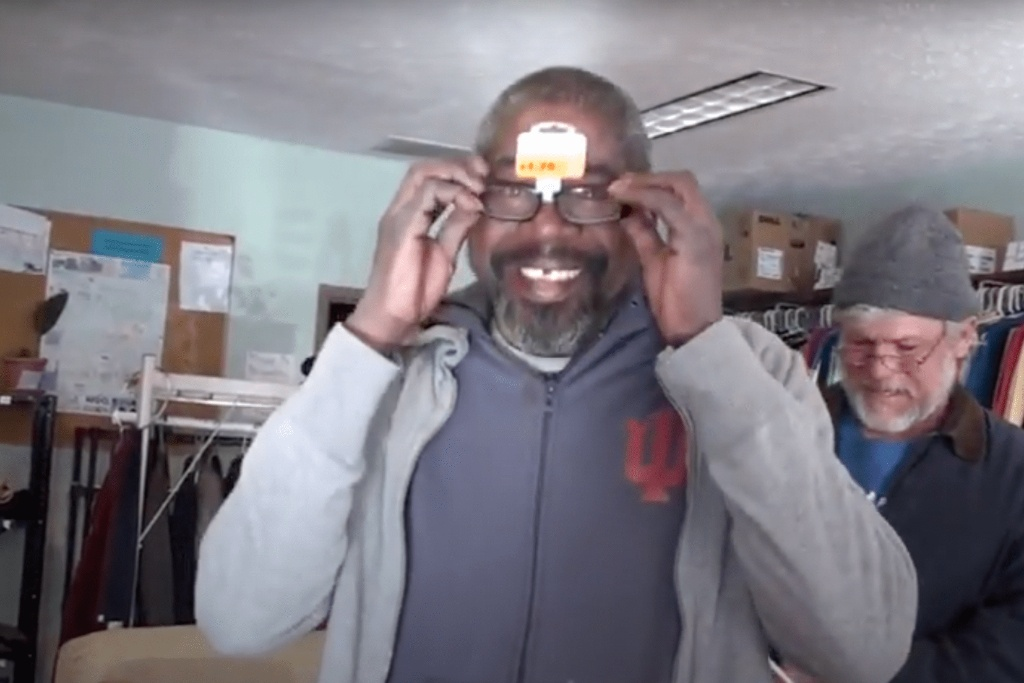 Client trying on reading glasses at the Transition Support Center