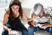 High angle view of a young couple playing video game
