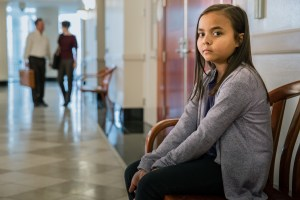 Image of young girl sitting outside court room