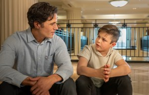 Image of young boy and CASA volunteer talking