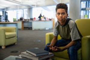 Image of young boy in a library