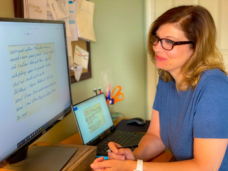 Woman reviewing old recipes by The New Moon Workshop