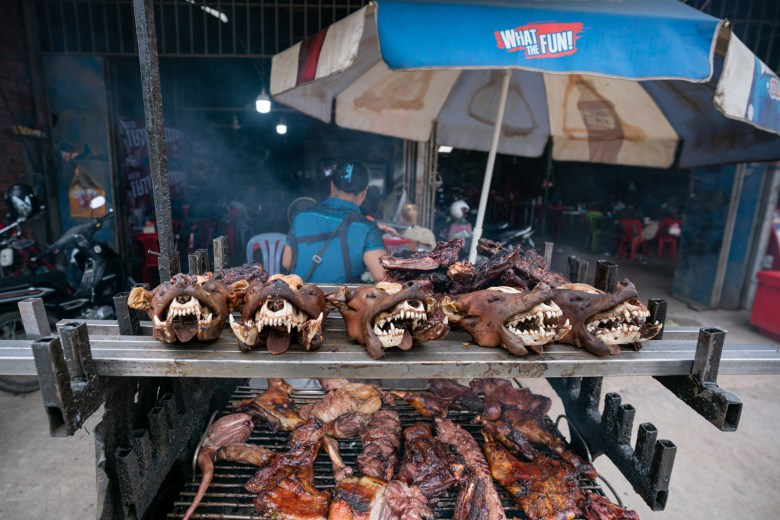 Dog heads and meat for sale in a roadside restaurant in Phnom Penh.