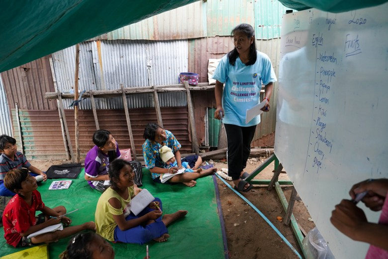 """Sreymai teaches young students in Phnom Penh's Stung Meanchey District while continuing her own studies online. """"I like this kind of busy,"""" she says. """"I like to keep myself working."""""""
