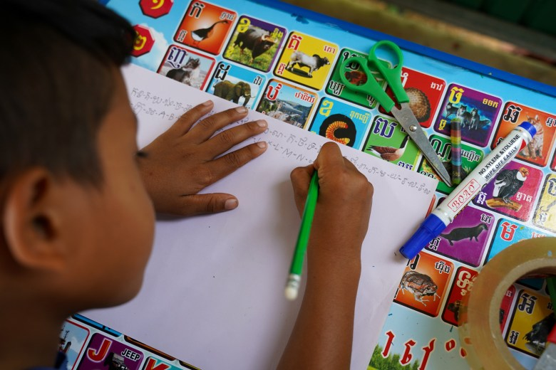 A student at the Village Library in Chreav Commune's BosKralanh Village studies by himself.