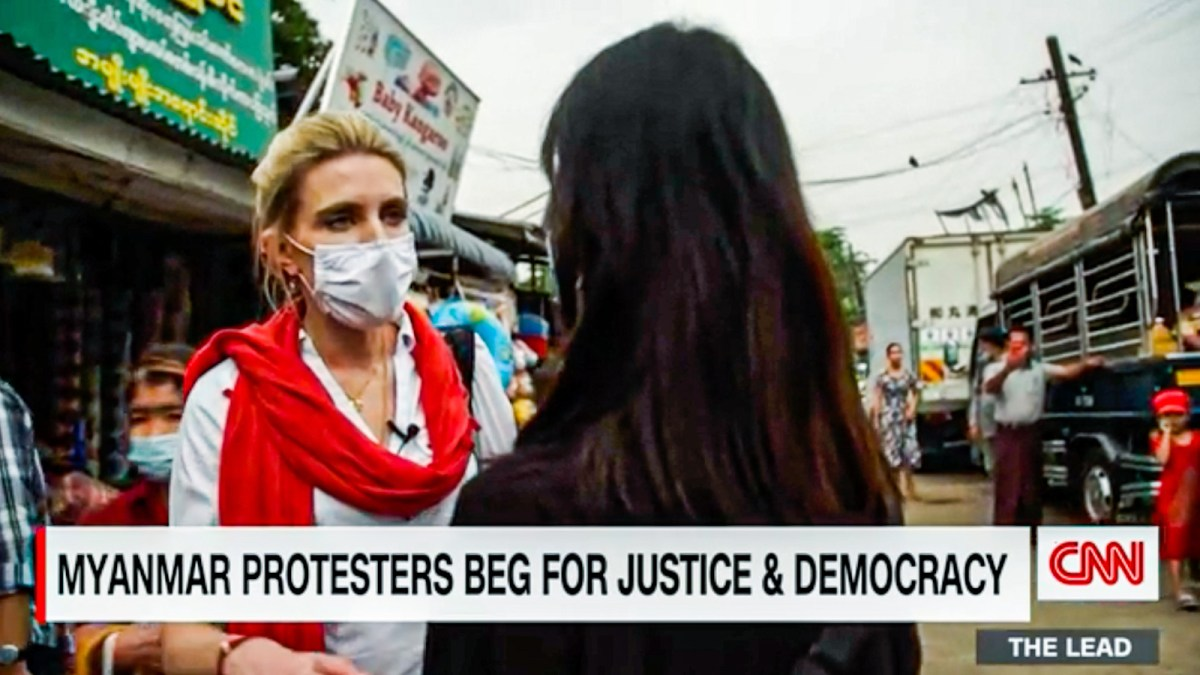A screenshot of a CNN video report with journalist Clarissa Ward interviewing a Myanmar person.