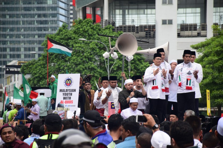 Demonstrators, including Khairy Jamaluddin, who is now Minister of Science, Technology and Innovation, gather in Kuala Lumpur on 8 December 2017 to protest the closure of Al-Aqsa Mosque in Jerusalem.