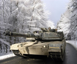 Members of the 1st Armored Division drive a M-1A Abrams tank through the Tuanus Mountains north of Frankfurt during the READY CRUCIBLE exercise held 7-17 February 2005.  This was the largest movement of American armored vehicles through German roads and farmland since the REFORGER exercises of the 1980's.