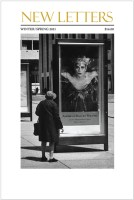 woman looking at a poster for a ballet performance