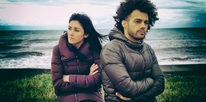 Unhappy Man And Woman Outdoors After Fight In Front Of The Ocean