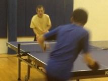 Tong Yu and Ronald Yu playing table tennis in Newport Beach