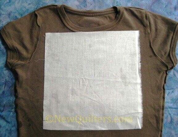 Photo of interfacing ironed to back side of t-shirt