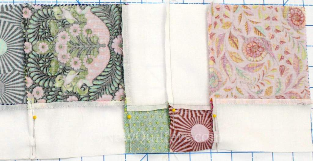 Photo showing quilt seams pinned together for sewing