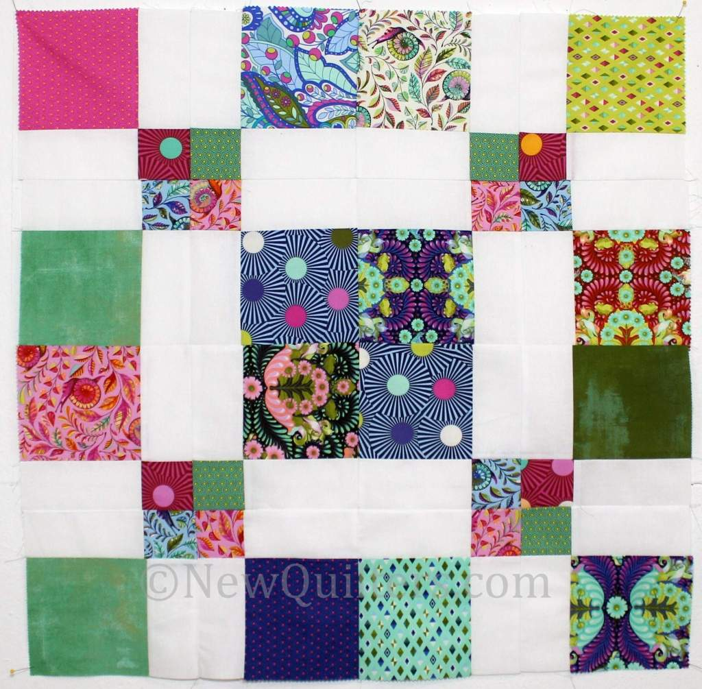 Photo showing disappearing nine-patch blocks segments rearranged into new quilt block