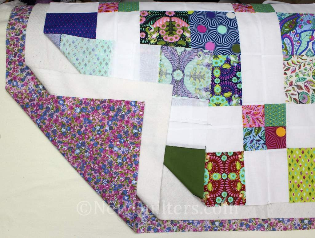 Photo showing quilt layers ready for basting
