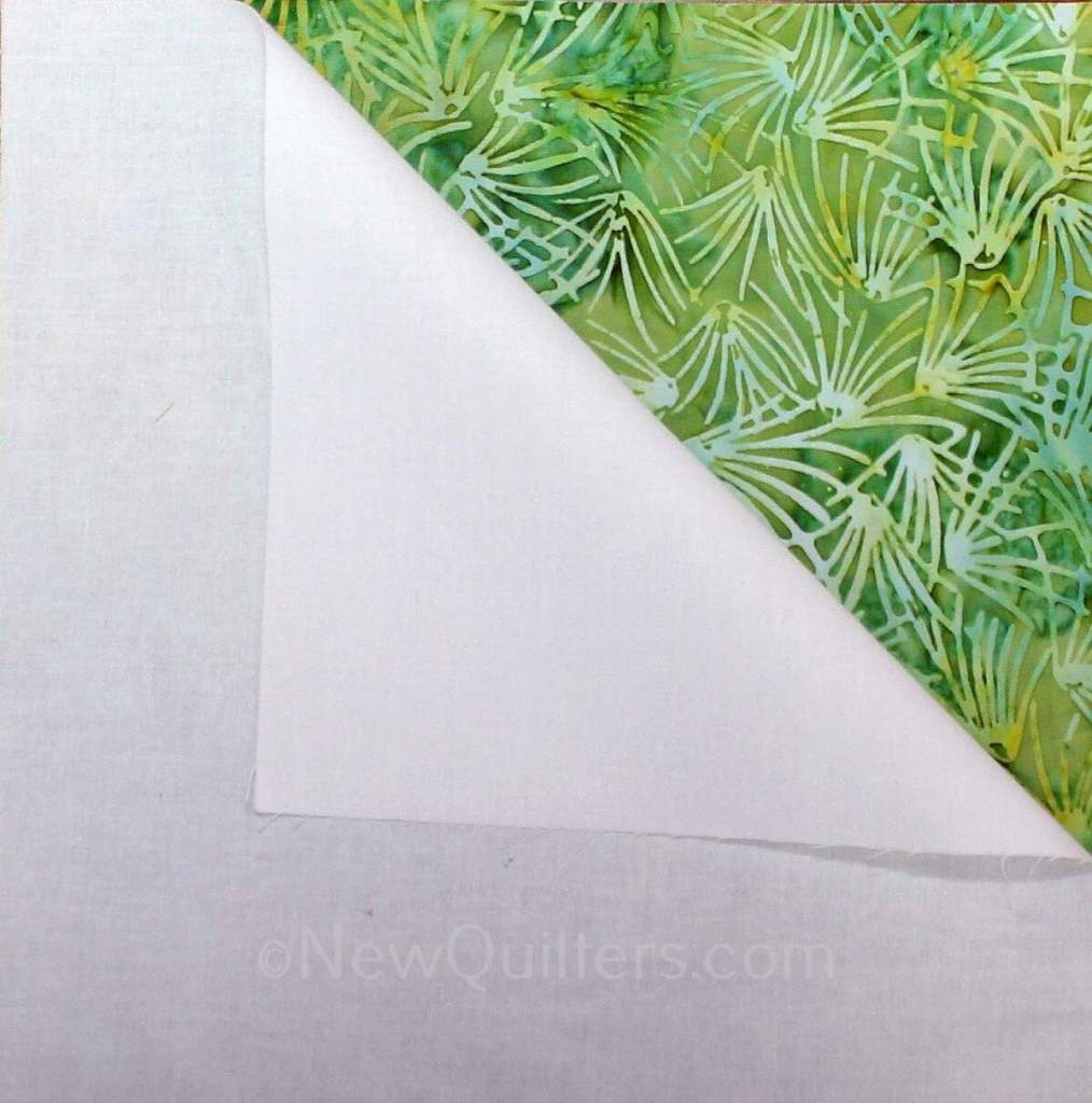 An easy way to make four half-square triangle quilt blocks from two fabric squares. No marking needed. #halfsquare triangleblocks, #halfsquaretriangleblockshowtomake, #halfsquaretriangleblockssimple