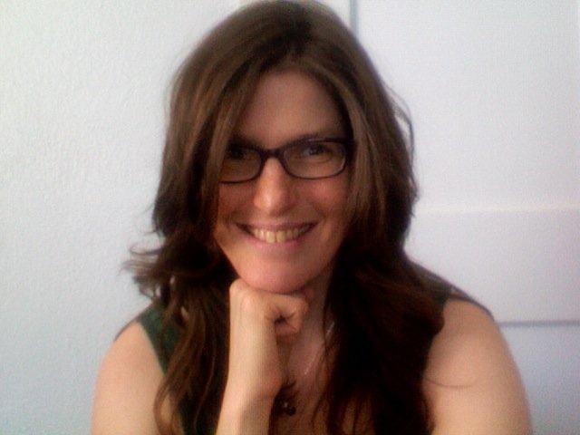 headshot of Laura with long hair