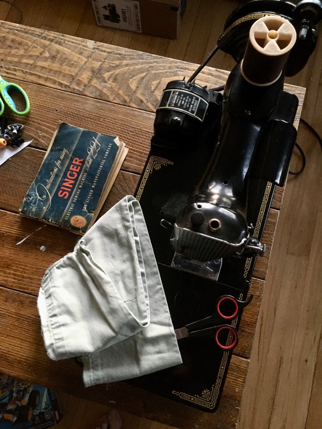 Singer Featherweight sewing machine with fabric, scissors, and manual
