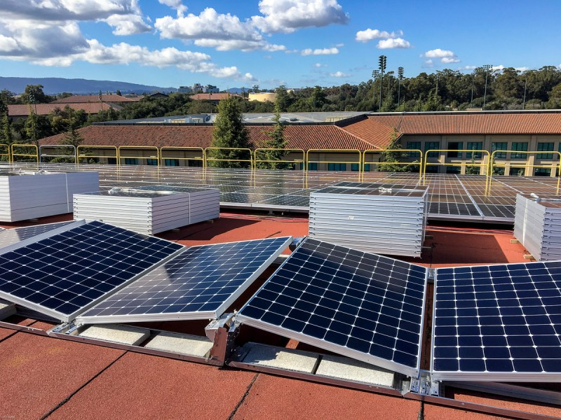 Sun   rooftop photovoltaic panels   electricity for Stanford         Photovoltaic panels on the roof of Maples Pavilion ready for  installation