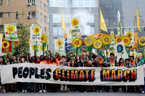 A majority of Americans favor cutting carbon emissions to protect air and water and address the impacts of climate change and global warning. 400,000 joined the People's Climate March in New York City in 2014. Republicans in Congress are trying to nullify Obama's Clean Power Plan in advance of the Climate Summit in Paris © 2015 Karen Rubin/news-photos-features.com