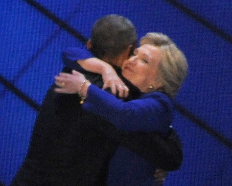 Hillary Clinton, surprising the DNC after President Obama's rousing speech, embraces Obama (c) 2016 Karen Rubin/news-photos-features.com