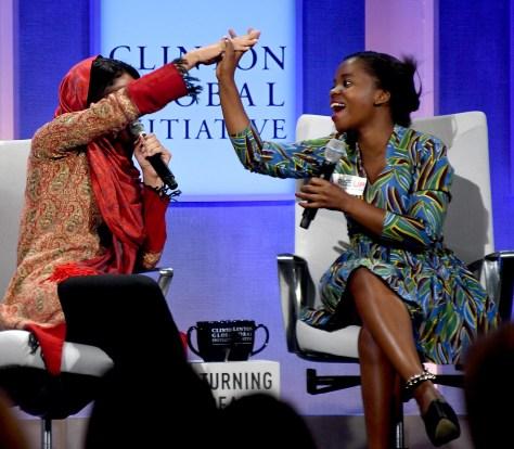 Sonita Alizadeh, artist and Activist, The Strongheart Group, high-fives Memory Banda, Girl Leader and Advisory Board Member, Rise Up © 2016 Karen Rubin/news-photos-features.com