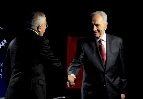 Israel President Shimon Peres greets Palestine National Authority Prime Minister Salam Fayyad at 2010 Clinton Global Initiative. © 2016 Karen Rubin/news-photos-features.com