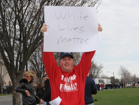 "Supporter at Donald Trump rally, Bethpage, Long Island, NY, holds sign, ""White Lives Matter"" © 2016 Karen Rubin/news-photos-features.com"