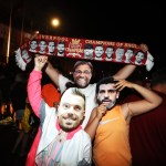 Liverpool fans wearing Jordan Henderson, Mohamed Salah and Jurgen Klopp face masks celebrate outside Anfield, Liverpool. (Photo by Martin Rickett/PA Images via Getty Images)