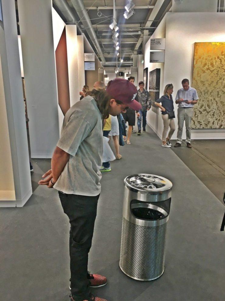 Massimo Agostinelli inspecting his impromptu work at Art Basel. Courtesy Massimo Agostinelli
