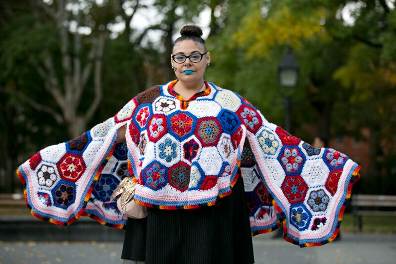 Daniela Puliti wearing her crocheted <em>Art, Empathy, Community, Voice, Choice & Vote</em> cape at Michele Pred's We Vote Parade. Photo by Pontus Hook.