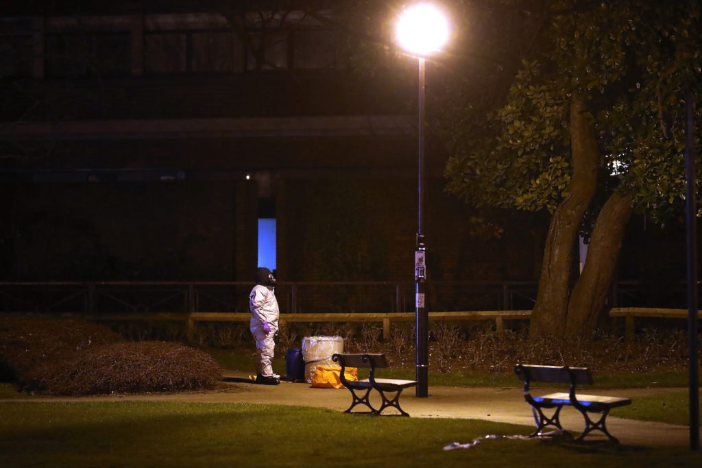 Police officers in forensics suits and protective masks work at the scene of the poisoning of Sergei Skripal on March 13, 2018 in Salisbury