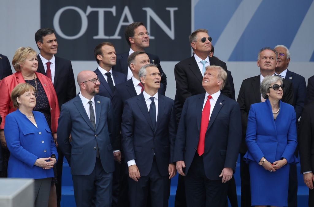 Left to right: German chancellor Angela Merkel, Belgian prime minister Charles Michel, NATO secretary general Jens Stoltenberg, U.S. President Donald Trump and British prime minister Theresa May attend the opening ceremony at the 2018 NATO Summit at NATO headquarters on July 11, 2018 in Brussels, Belgium. Photo by Sean Gallup/Getty Images.