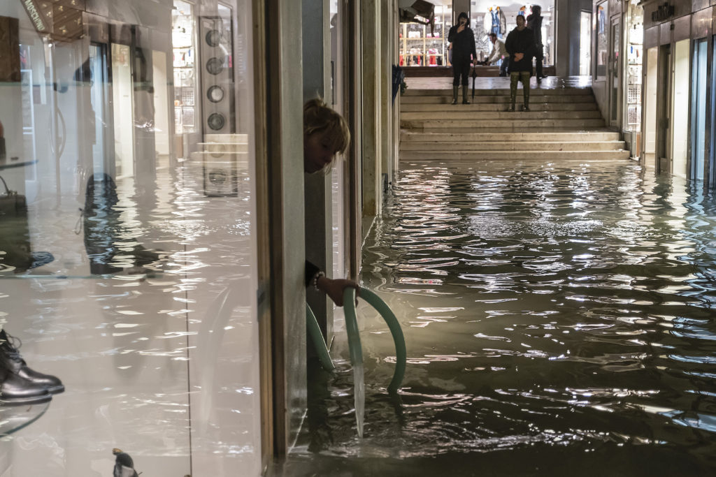 pharmacy uses an electric pump during the floods in Venice on November 12, 2019. Photo by Stefano Mazzola/Awakening/Getty Images.