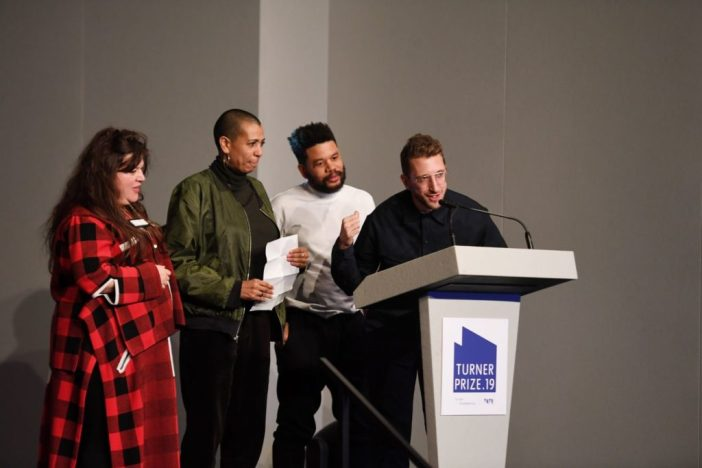 Tai Shani, Helen Cammock, Oscar Murillo and Lawrence Abu Hamdan celebrate after being announced as the joint winners of Turner Prize 2019 by Edward Enninful, Editor-in-Chief of British Vogue in Margate. Photo by Stuart C. Wilson/Stuart Wilson/Getty Images for Turner Contemporary.