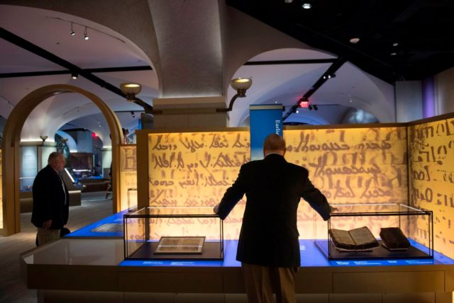 "Visitors tour the ""History of the Bible"" exhibit at the Museum of the Bible n Washington, DC. Photo by Saul Loeb, courtesy of AFP Photo/Getty Images."