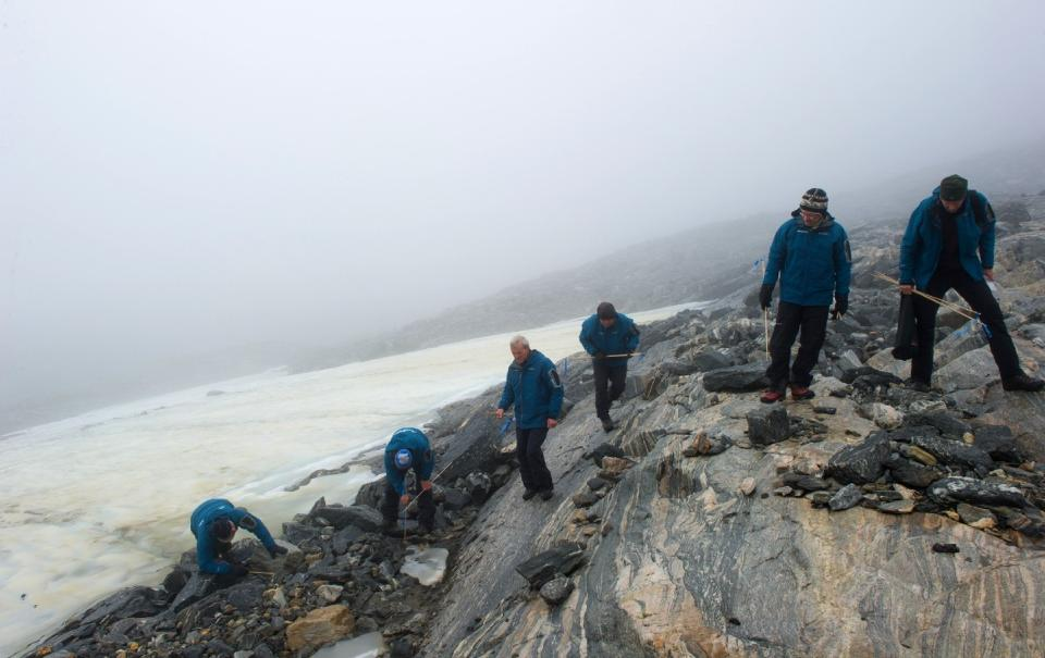 Members of the Secrets of the Ice team surveying the Lendbreen pass. Photo by Johan Wildhagen, Palookaville.