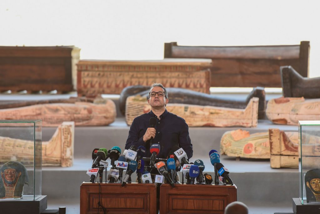 Egyptian Minister of Antiquities and Tourism Khaled El Anany speaks during a press conference at Saqqara to announce the discovery of at least 100 ancient coffins, some with mummies inside. Photo: Mohammed Fouad/dpa via Getty Images.